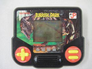 Working Electronic Handheld Tiger Jurassic Park Game 1988