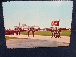 Lackland AFB. San Antonio, Texas. Trainees march past reviewing stand