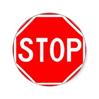 Round sticker with Stop sign.