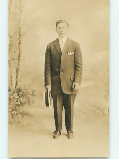 Pre 1920s RPPC Man Holds His Hat at Side at Studio in Pennsylvania PA
