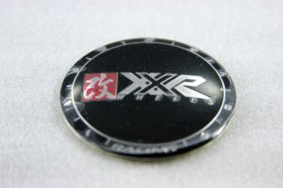 XXR Wheels Center Cap. The outer cap is flat black, and the XXR Wheels