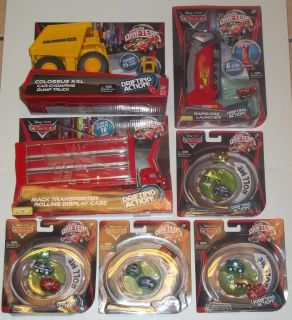 New Disney Cars Micro Drifters Lot Launcher Colossus Dump Truck Mack
