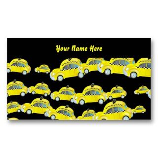 Lots of little cute yellow New York taxi cabs set against a black