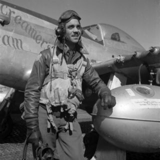 Tuskegee Fighter Pilot Poses with His P 51D Mustang, Ramitelli, Italy, March 1945 Premium Poster