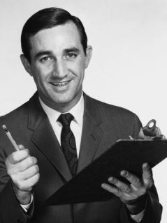 Man Holding Clipboard and Pencil Photographic Print