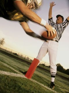 Football Player Scoring a Touchdown with a Referee in The Background Photographic Print