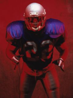 Portrait of an American Football Player Standing in a Tackle Pose Photographic Print