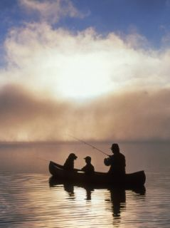 Silhouetted Father and Son Fishing from a Canoe Photographic Print by Bob Winsett