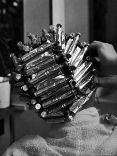 Woman at Beauty Salon in curlers and tinfoil for permanent waves hairstyle in late 30s and 40s Premium Photographic Print by Alfred Eisenstaedt