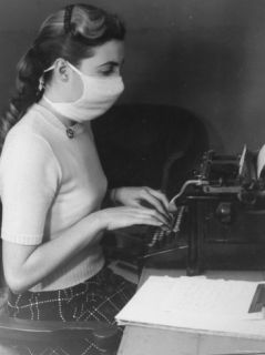 Typist in Office Wearing Surgical Mask as a Prophylactic Measure During Influenza Outbreak Premium Photographic Print