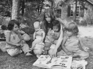Actress Mia Farrow Reading to Her Adoptive Vietnamese Daughter Lark and Others Outside at Home Premium Photographic Print by Alfred Eisenstaedt