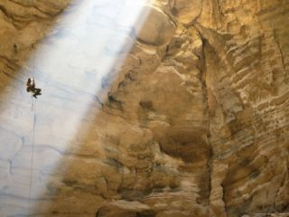 Man Descends Majlis Al Jinn Cave Photographic Print by Stephen Alvarez