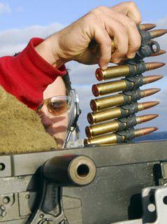 Aviation Ordnanceman Reloads a 50 Caliber Machine Gun Photographic Print by Stocktrek Images
