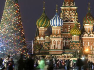 People Walk Along Red Square in Moscow, Decorated for New Year Celebrations Photographic Print