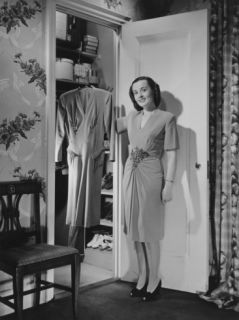 Woman Holding Dress at Opened Doors of Dressing Room Photographic Print by George Marks