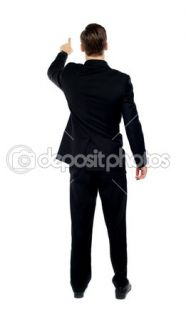 Rear view of a male model pointing  Stock Photo © stockyimages