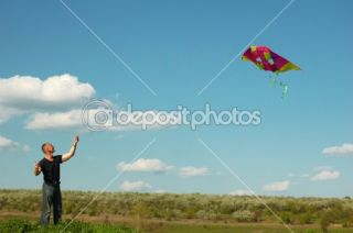 Young man flying a kite  Stock Photo © Elena Titarenco #1329674