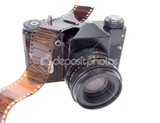 Old camera and film reel  Stock Photo © Vitaly Gariev #1449669