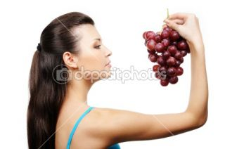 Young girl holding bunch of grapes  Stock Photo © Vitaly Valua